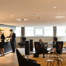 Passengers eating and drinking in the First Class Section of the Star Alliance Lounge