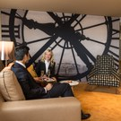 The iconic clock of the Musée d'Orsay in Paris as a backdrop in the Star Alliance Lounge