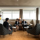 Passengers sitting in the Frist Class section in the Star Alliance Lounge