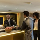 Passengers being welcomed to the Star Alliance Lounge
